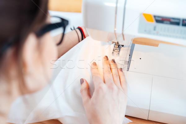 Nő dolgozik varr stúdió fiatal nő szemüveg Stock fotó © deandrobot