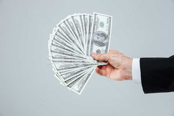 Stock photo: Hand of businessman holding money