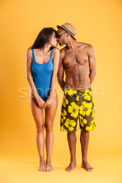 Loving young couple in swimwear kissing Stock photo © deandrobot