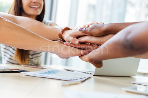 Business people joining their hands together Stock photo © deandrobot