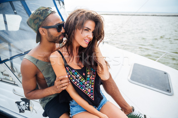 Beautiful couple smiling and embracing on yacht Stock photo © deandrobot