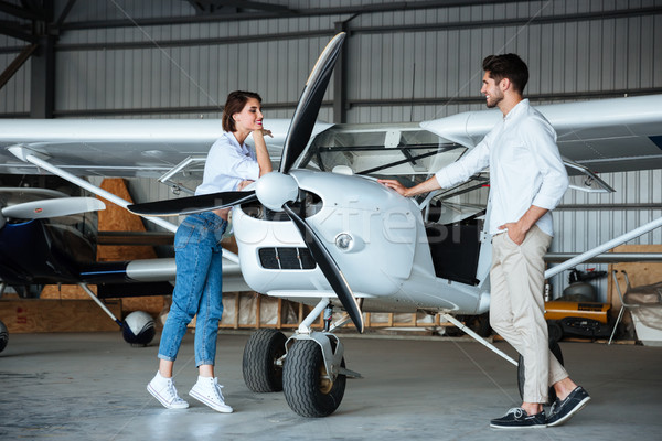 Happy young couple standing near small plane Stock photo © deandrobot