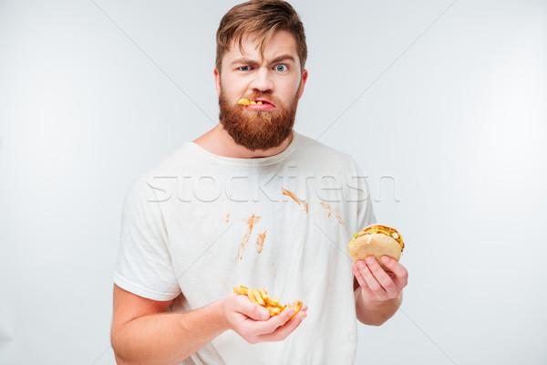 Stock fotó: Vicces · éhes · szakállas · férfi · eszik · egészségtelen · étel