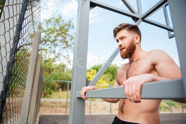 Fiatal brutális szakállas erős férfi sportok Stock fotó © deandrobot