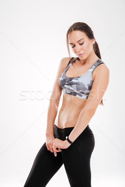 Kobieta stwarzające studio pionowy obraz Zdjęcia stock © deandrobot