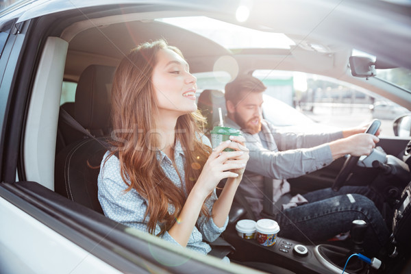 Side view of fashion couple in car Stock photo © deandrobot