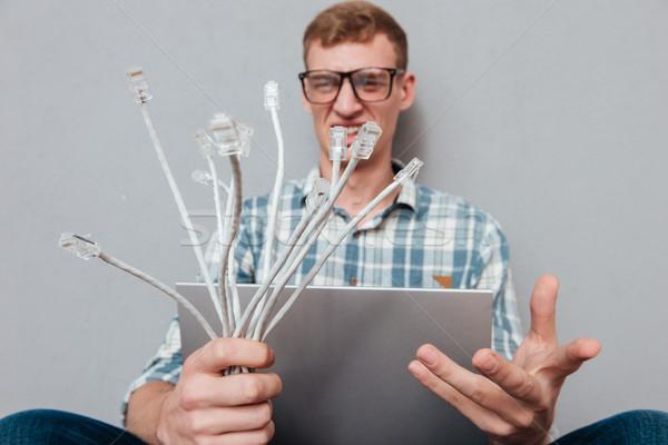 Fiatal diák szemüveg laptop kábelek elöl Stock fotó © deandrobot