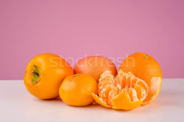 Vers fruit mandarijn- persimmon mandarijn oranje tabel Stockfoto © deandrobot