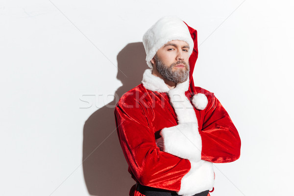 Serious santa claus standing with arms crossed Stock photo © deandrobot