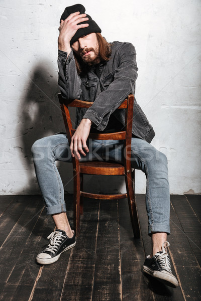 Portrait of a hipster man sitting on chair Stock photo © deandrobot