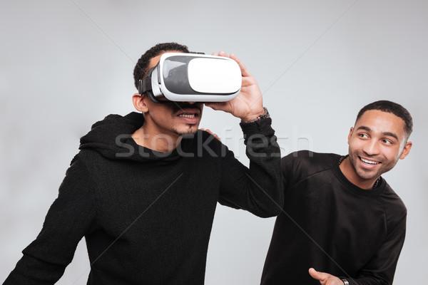 Heureux africaine jeunes hommes 3D réalité Photo stock © deandrobot