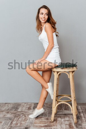 Woman in black lingerie with stockings holding gift box Stock photo © deandrobot