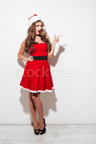 женщину красный Дед Мороз платье указывая пальца Сток-фото © deandrobot