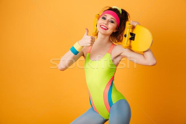 Genç fitness woman kaykay Stok fotoğraf © deandrobot