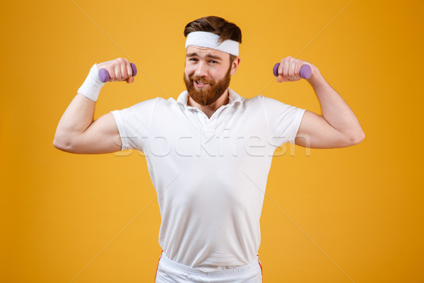 Funny retro sportsman with lightweight dumbbells Stock photo © deandrobot