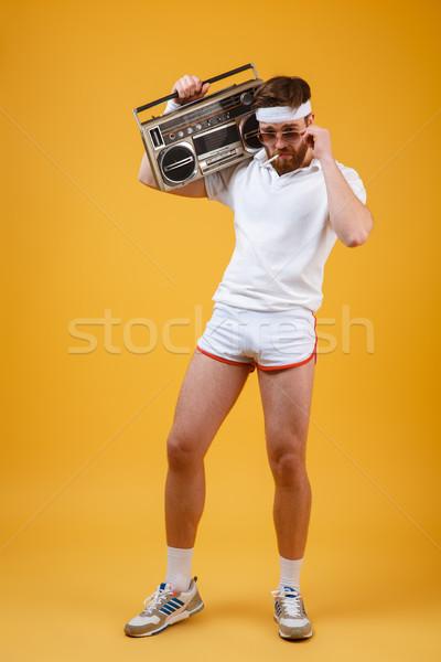 Jóképű fiatalember tart szalag furulya cigaretta Stock fotó © deandrobot