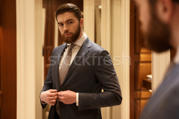 bearded man looking at the mirror stock photo dean drobot