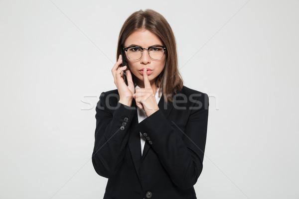 Retrato jovem sério empresária óculos terno Foto stock © deandrobot