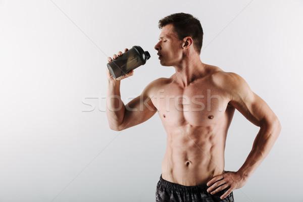 Komoly fiatal sportoló ivóvíz kép erős Stock fotó © deandrobot