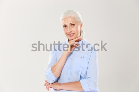 Portrait of beautiful smiling senior lady, touching her chin, lo Stock photo © deandrobot