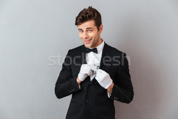 Сток-фото: красивый · молодые · официант · деньги · фото