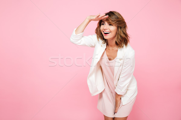 Portrait of a smiling cheerful girl in summer clothes Stock photo © deandrobot