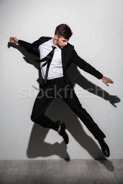 Foto bonito caucasiano homem terno preto Foto stock © deandrobot