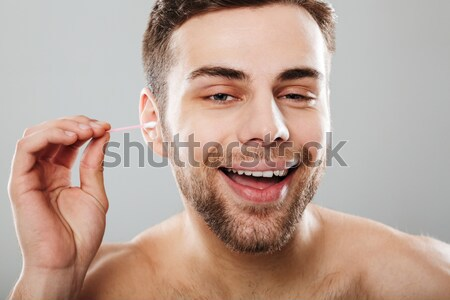 Close up portrait of a satisfied half naked man Stock photo © deandrobot