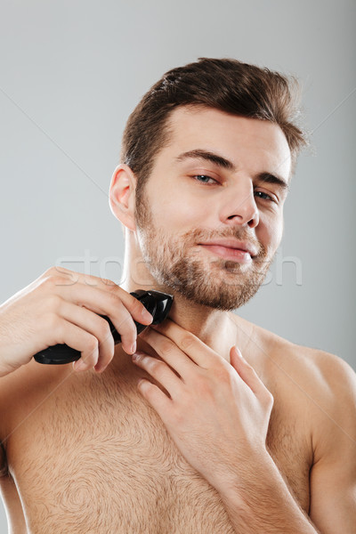 Picture of good-looking adult guy doing hygiene and health proce Stock photo © deandrobot