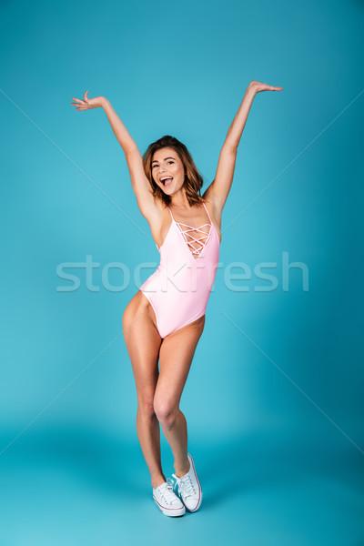 Portret happy girl strój kąpielowy stwarzające stałego Zdjęcia stock © deandrobot