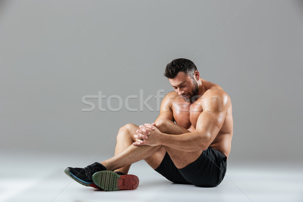 Portrait of a tired strong shirtless male bodybuilder resting Stock photo © deandrobot