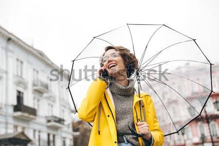 Elképesztő portré boldog nő citromsárga esőkabát Stock fotó © deandrobot