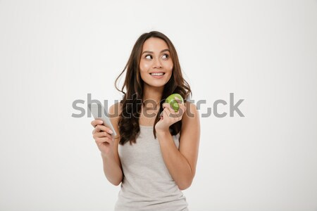 Portrait of gorgeous healthy woman looking aside while posing on Stock photo © deandrobot