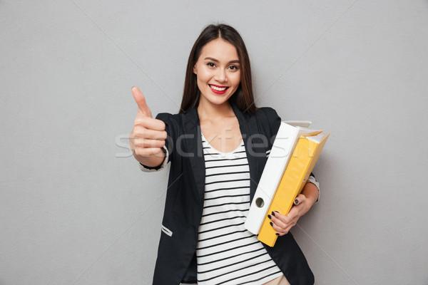 Felice asian donna d'affari cartelle Foto d'archivio © deandrobot