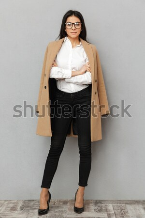 Full length image of Pleased asian woman in business clothes Stock photo © deandrobot