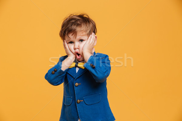 Shocked screaming boy child standing isolated Stock photo © deandrobot