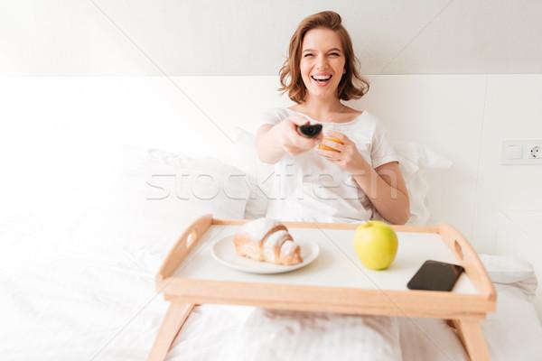 Mosolyog fiatal hölgy óra tv tart Stock fotó © deandrobot