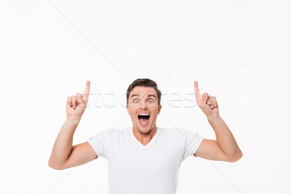Portrait excité homme blanche tshirt permanent Photo stock © deandrobot