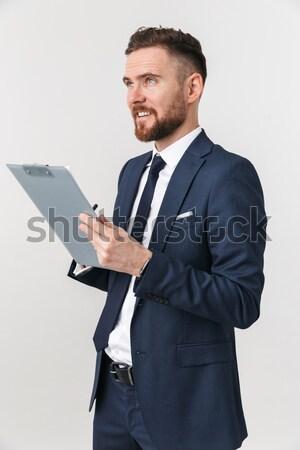 Portrait of a confident bearded man using laptop computer Stock photo © deandrobot