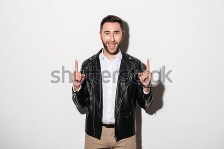 Portret szczęśliwy wesoły człowiek kurtka wskazując Zdjęcia stock © deandrobot