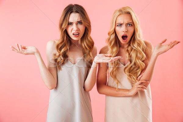 Twee verward mooie vrouwen pyjama Stockfoto © deandrobot