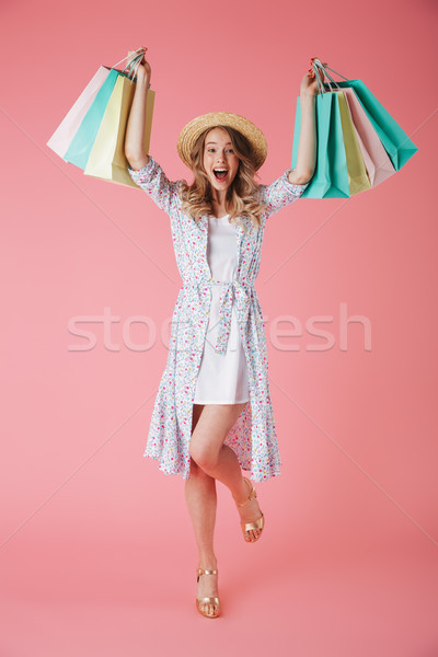 Stock photo: Full length portrait of a joyful young woman in summer dress