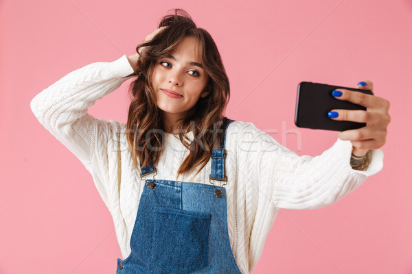 Portrait of a pretty young girl taking a selfie Stock photo © deandrobot