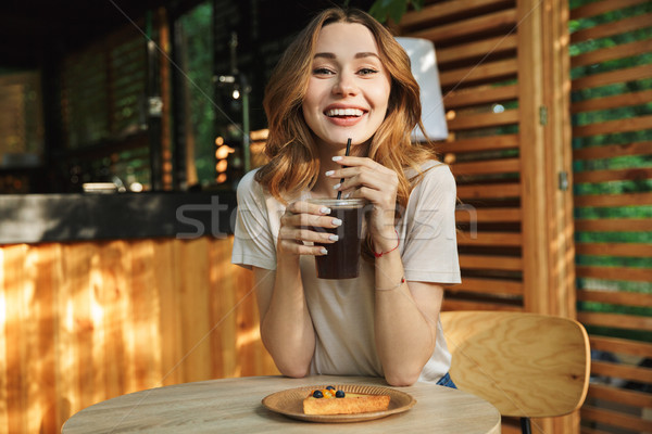 Portrait of a happy young girl drinking lemonade Stock photo © deandrobot