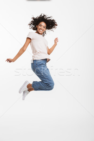 Full length portrait of satisfied american woman wearing jeans a Stock photo © deandrobot
