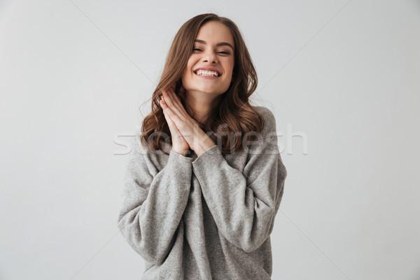 Soddisfatto bruna donna maglione posa braccia Foto d'archivio © deandrobot