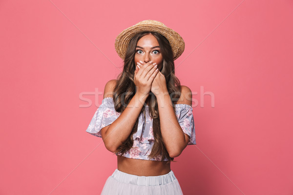 Image of scared or amazed woman 20s wearing straw hat covering m Stock photo © deandrobot