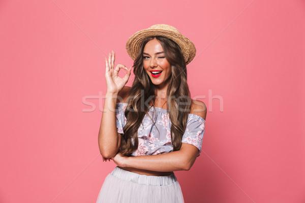 Portrait of beautiful european woman 20s wearing straw hat winki Stock photo © deandrobot