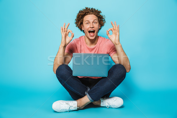 Image of hipster content man 20s with brown curly hair smiling a Stock photo © deandrobot