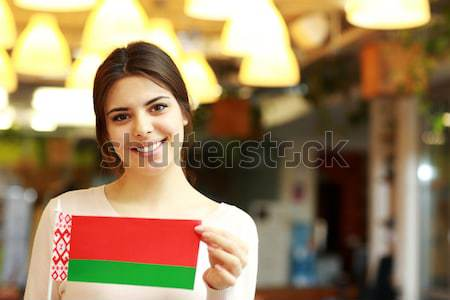 Feliz feminino estudante bandeira Romênia Foto stock © deandrobot